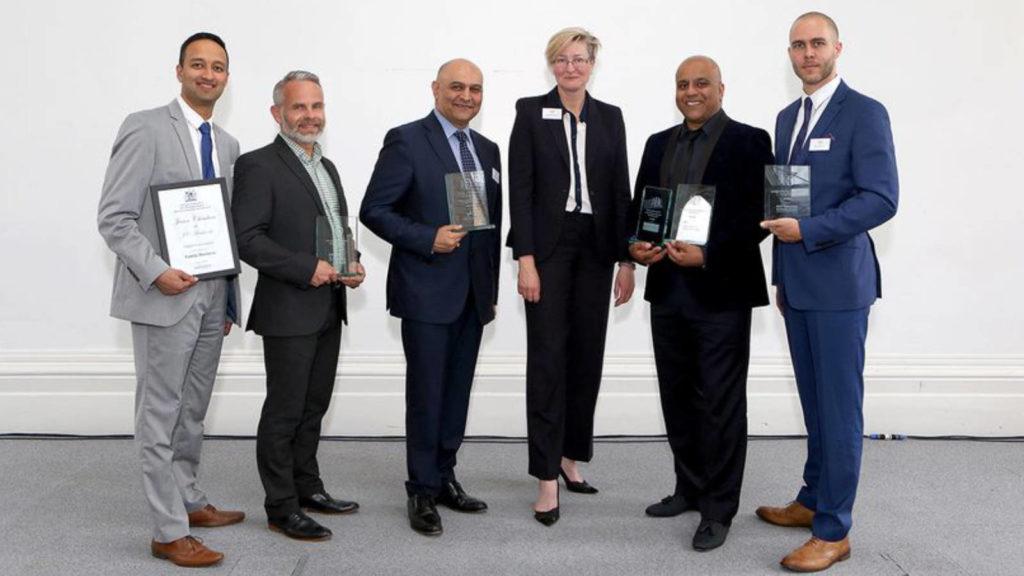 Dr Nik Kotecha OBE winning three IoD (Institute of Directors awards).