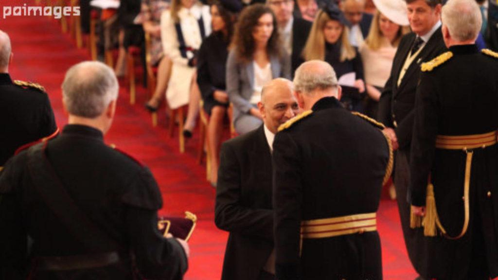 Dr Nik Kotecha OBE receiving an OBE from HRH Prince Charles..