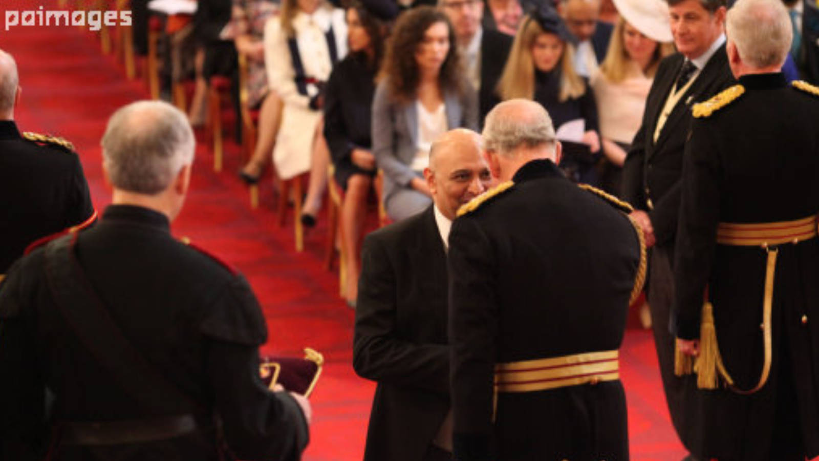 Dr Nik Kotecha OBE receiving an OBE from HRH Prince Charles..