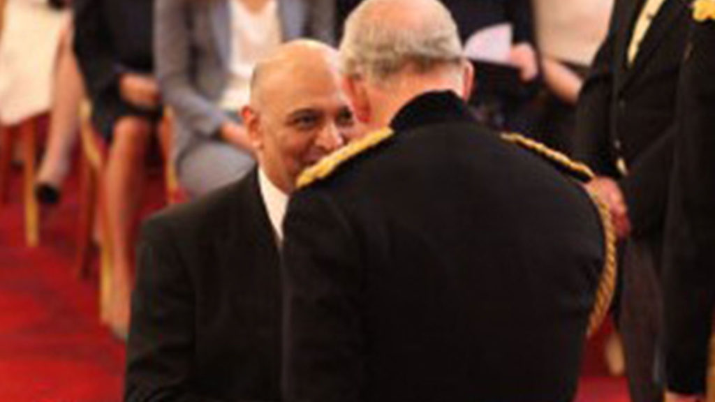Dr Nik Kotecha OBE receiving an OBE from HRH Prince Charles.