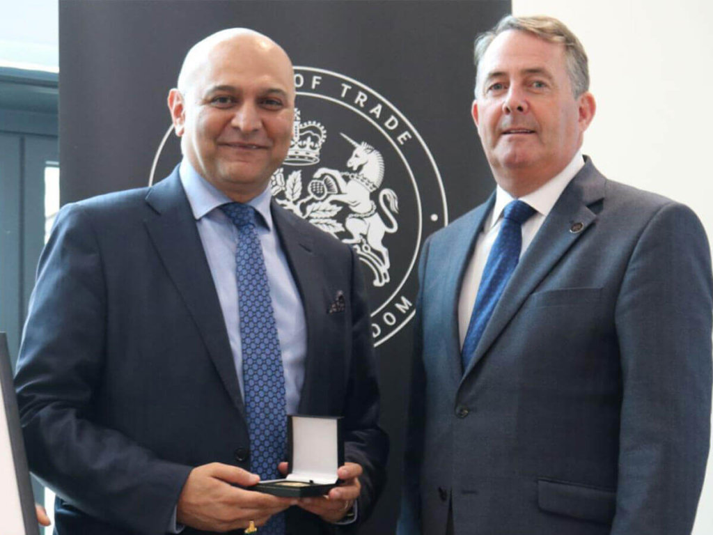 Dr Nik Kotecha OBE, Chief Executive of Morningside Pharmaceuticals, receiving a Board of Trade Award, from Secretary of State for the Department for International Trade